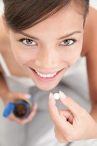 Vitamin E for skin Woman Taking Vitamin
