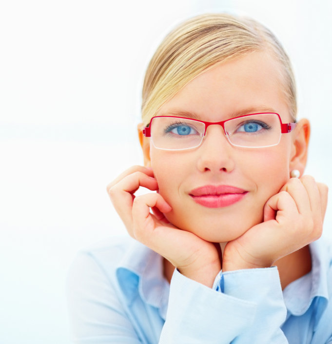 Closeup portrait of a blonde woman with hands under chin wearing glasses