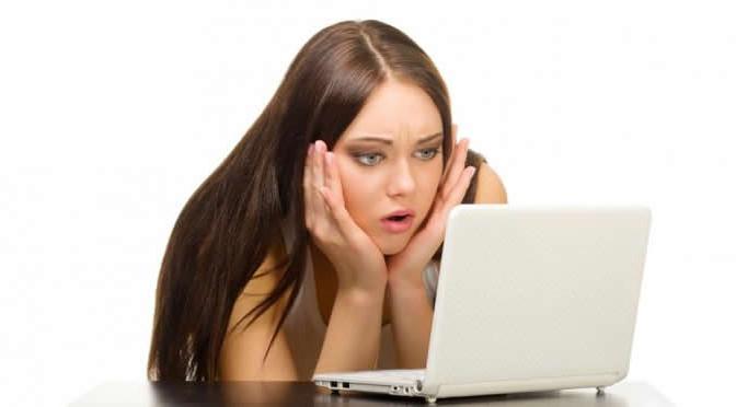 woman sad computer