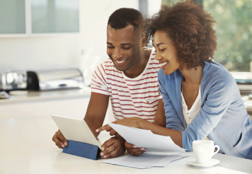 Couple on Tablet Aflac Insurance
