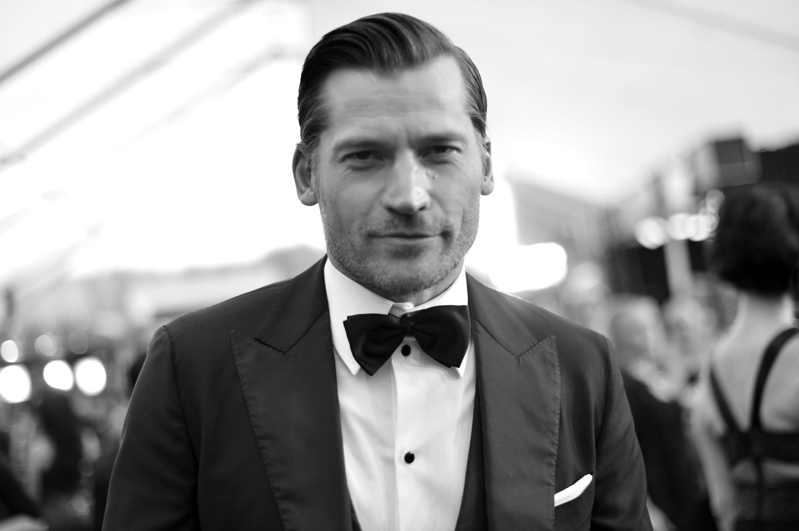 man in suit esquire black and white