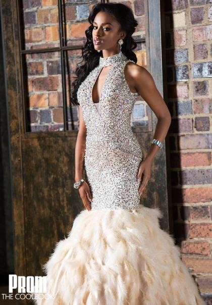 black girl in cutout mermaid sequin prom dress with feathers