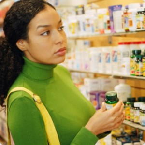 Vitamin C for skin - woman shopping for vitamins