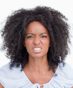 Angry Curly-Haired Woman