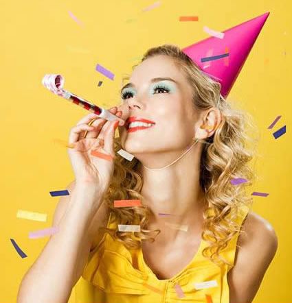 young_woman_wearing_party_hat_with_party_blower_