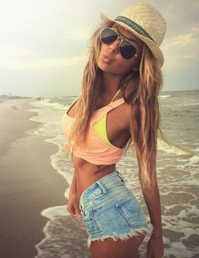 Girl on Beach with Great Tan in Fedora and Sunglasses