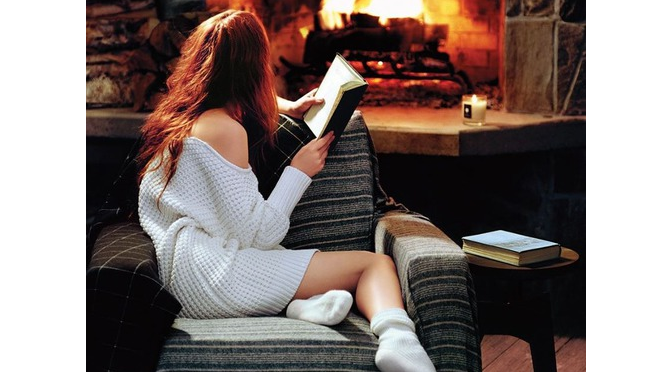 den-cozy-woman-socks-fireplace-reading