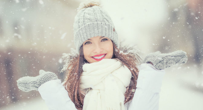 Beautiful Smiling Young Woman In Warm Clothing With Cup Of Hot Tea Coffee Or Punch. The Concept Of