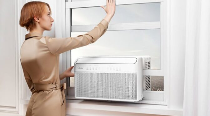redhead woman with window AC unit
