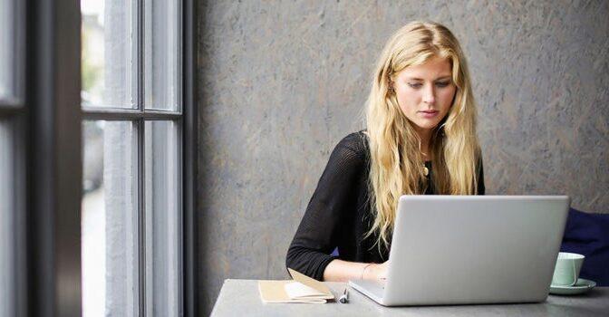 blonde woman using internet laptop