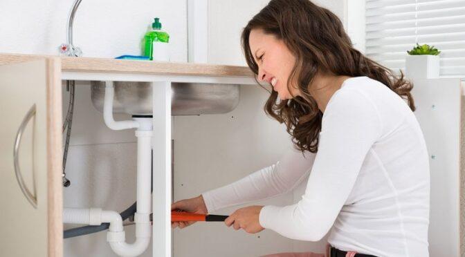 Millennial woman plumber